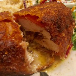 Prosciutto wrapped Chicken Kiev with garlic, blue cheese and bacon jam butter filling